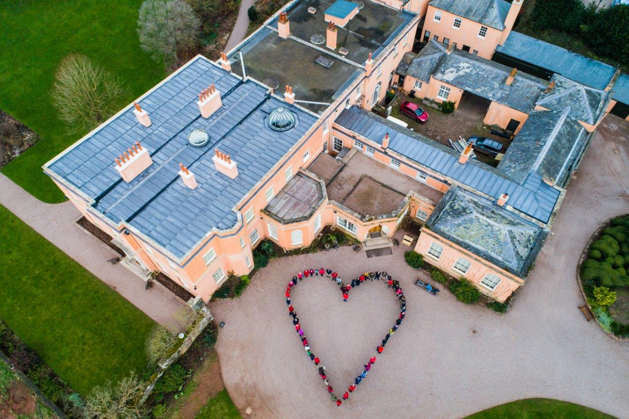 Killerton House aerial shot with volunteers in heart shape